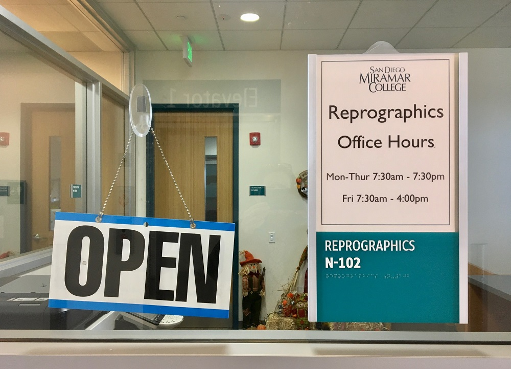 Photo of the Reprographics Department sign