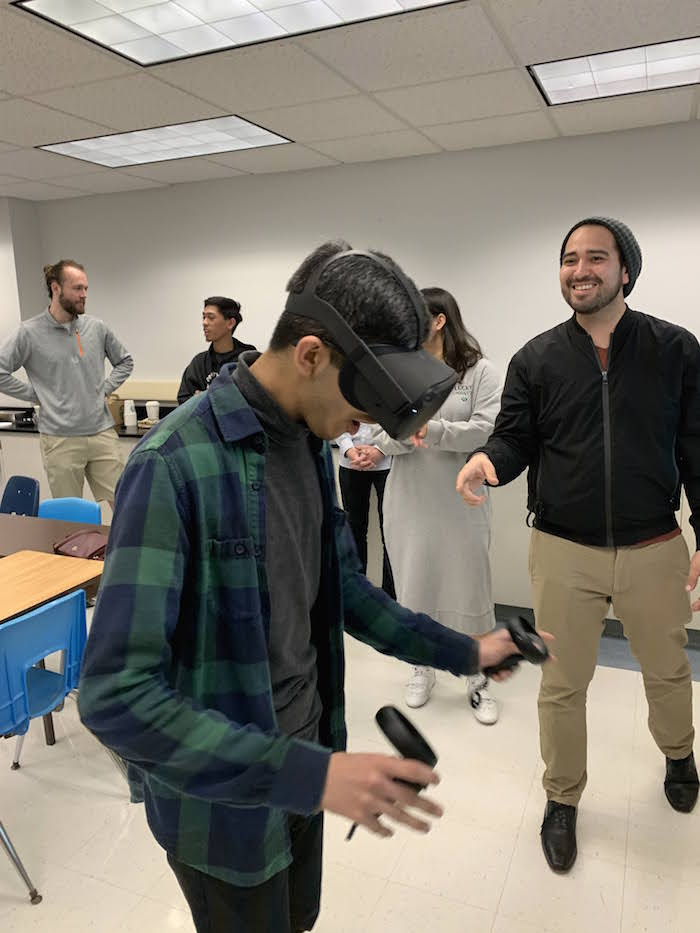Student, Rohan, trying virtual reality for the first time