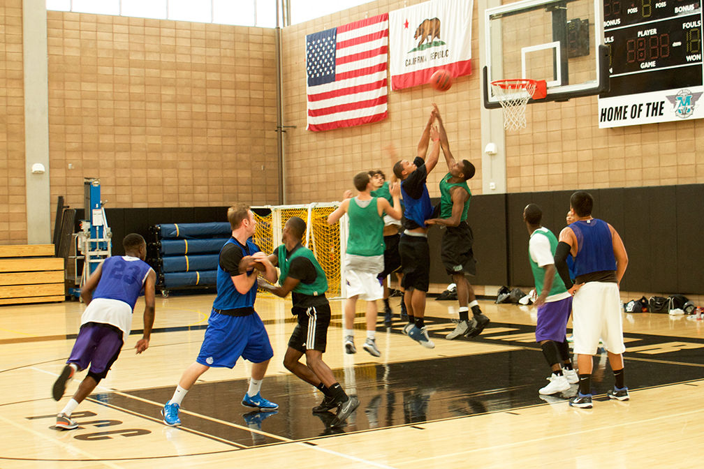 Photo of men playing basketball inside the Hourglass Fieldhouse gym